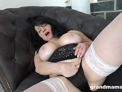 Mature sticks whole dildo into her communistic cherry after a nice solo